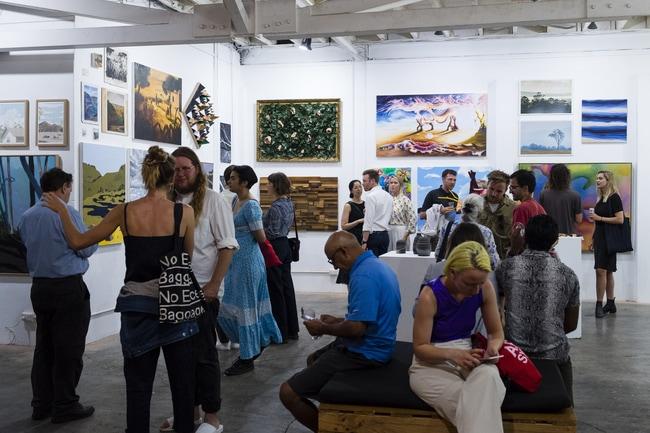 Locals attending exhibiton at aMBUSH Gallery