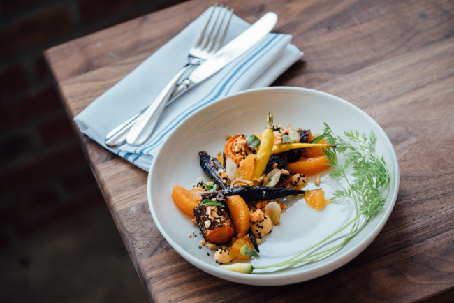 Plate of beautifully cooked vegetables with parsley garnish