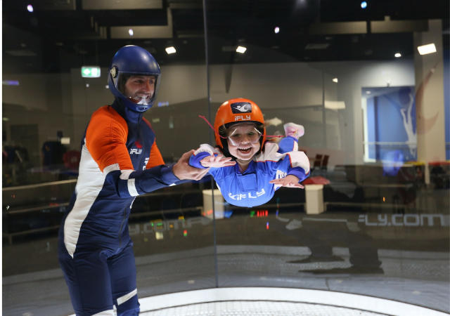 girl being taught to skydive by instructor