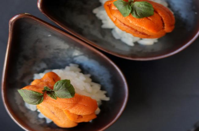 hand-made sushi prepared on a teardrop-shaped plate