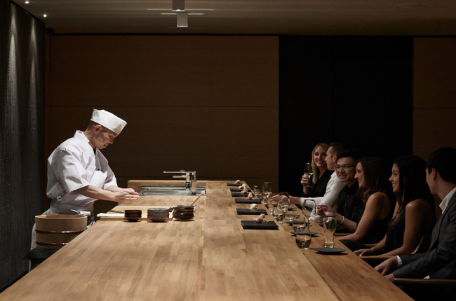 A Japanese chef preparing food for customers