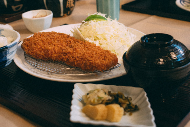 tonkatsu on a plate with cabbage