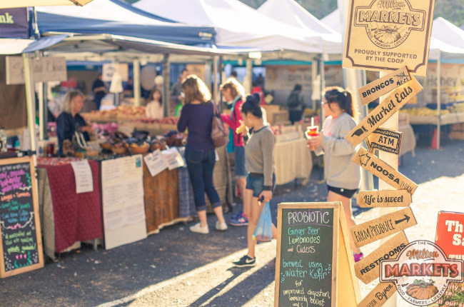 people browsing a selection of food stalls