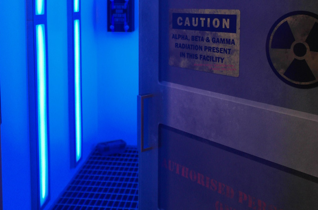 someone entering a puzzle room filled with blue neon light